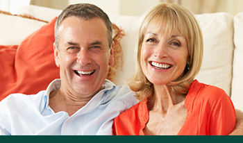 Smiling-middle-aged-couple-with-dental-implants